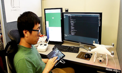 Hao Kang, co-investigator for FlyCam, works on the touch-screen navigation system.